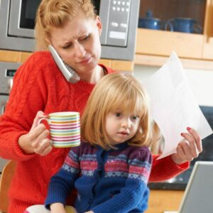 Busy Mother Coping With Stressful Day At Home