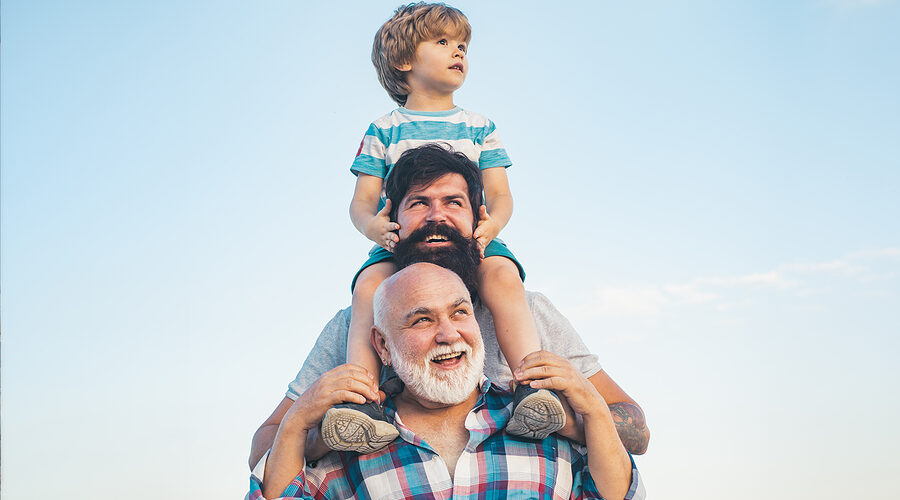 Men Generation: Grandfather Father And Grandson Are Hugging Look